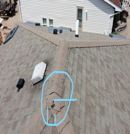 Cracked roof shingle